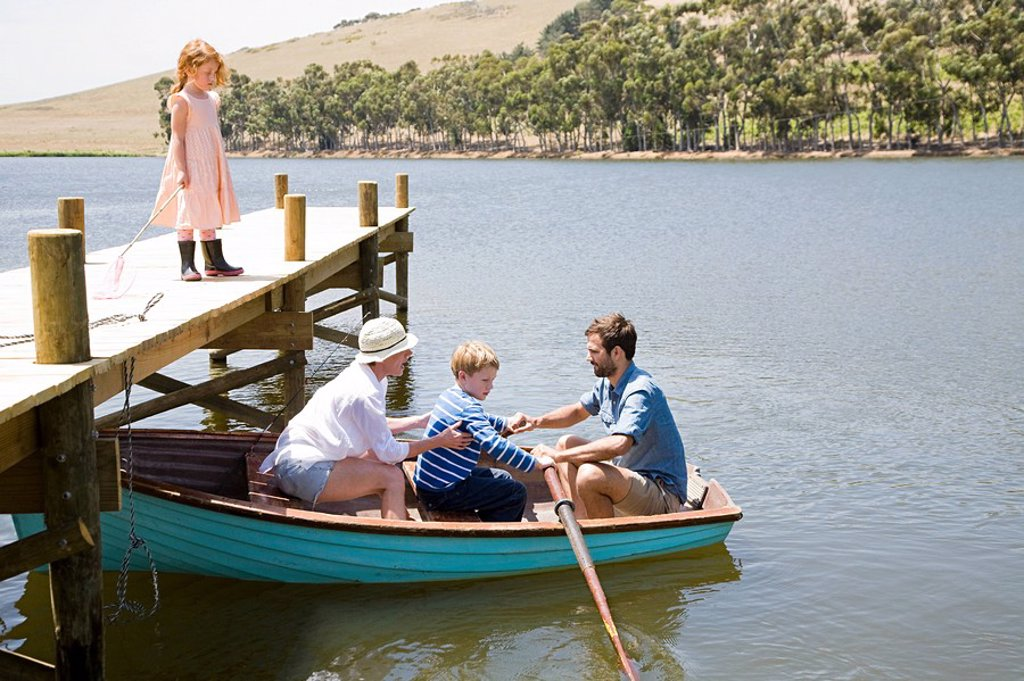 Family with rowing boat : Stock Photo