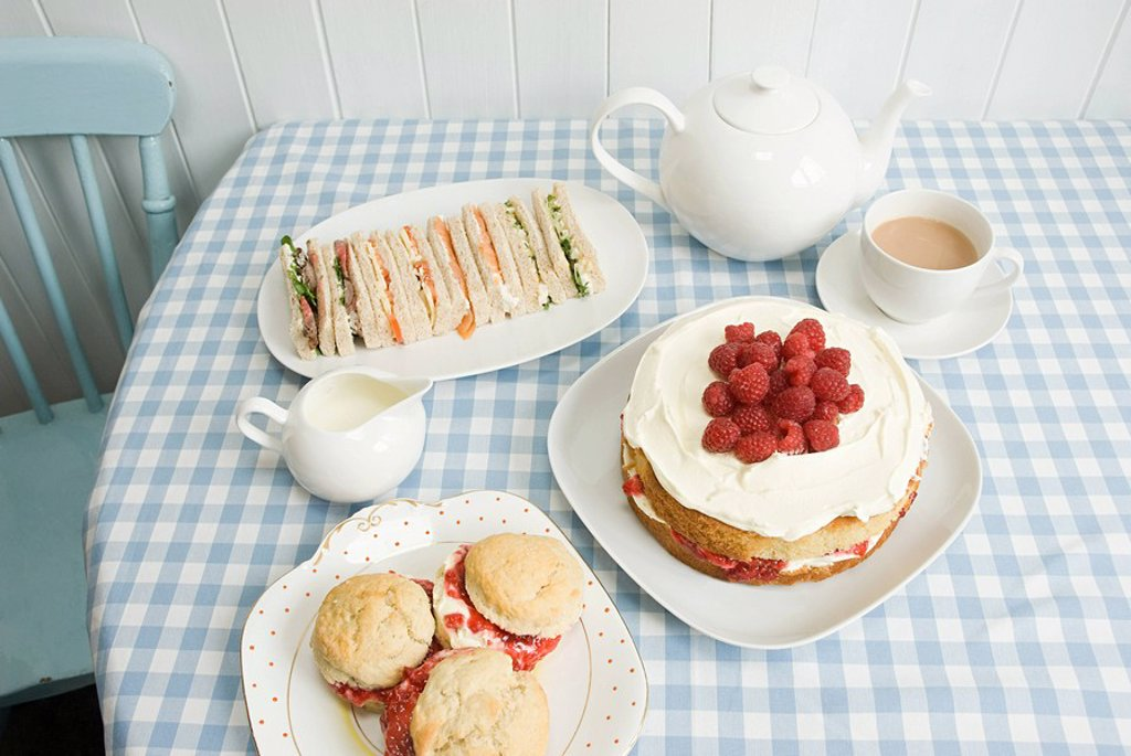 Tea with sandwiches and cakes : Stock Photo