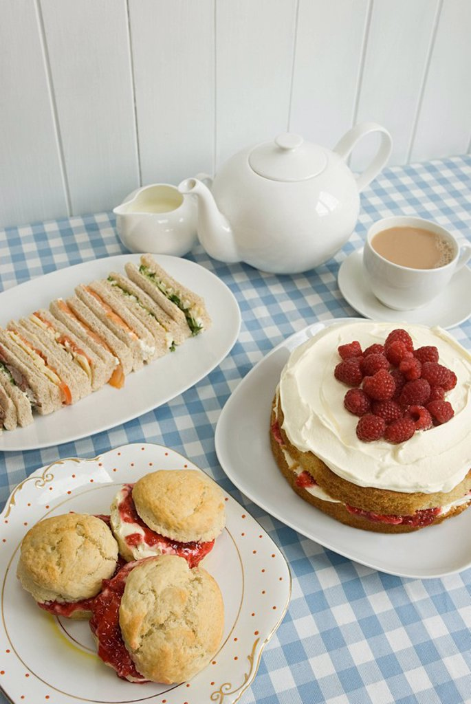 Stock Photo: 1439R-1133034 Tea with sandwiches and cakes