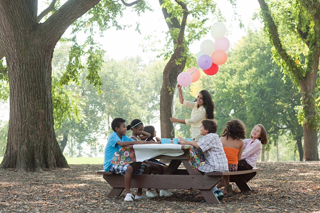 Outdoor birthday party with balloons : Stock Photo