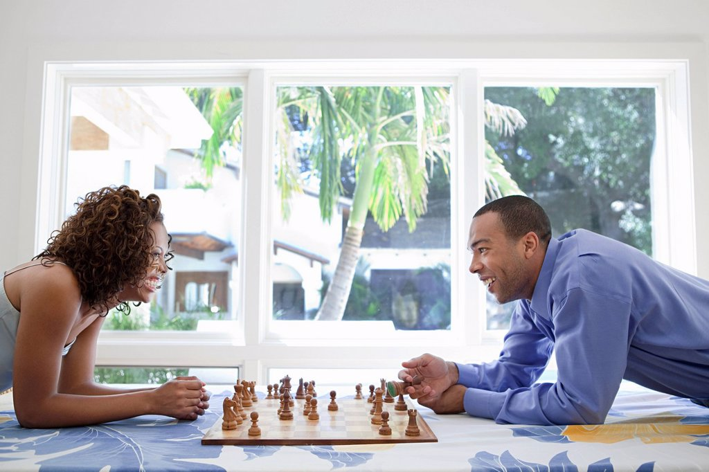 Stock Photo: 1439R-1133664 Young couple playing chess