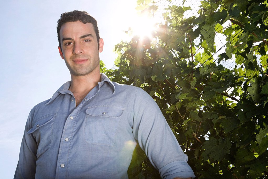 Young man in vineyard : Stock Photo