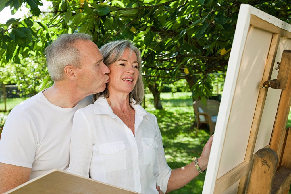 Stock Photo: 1439R-1133756 Mature couple, woman painting at easel