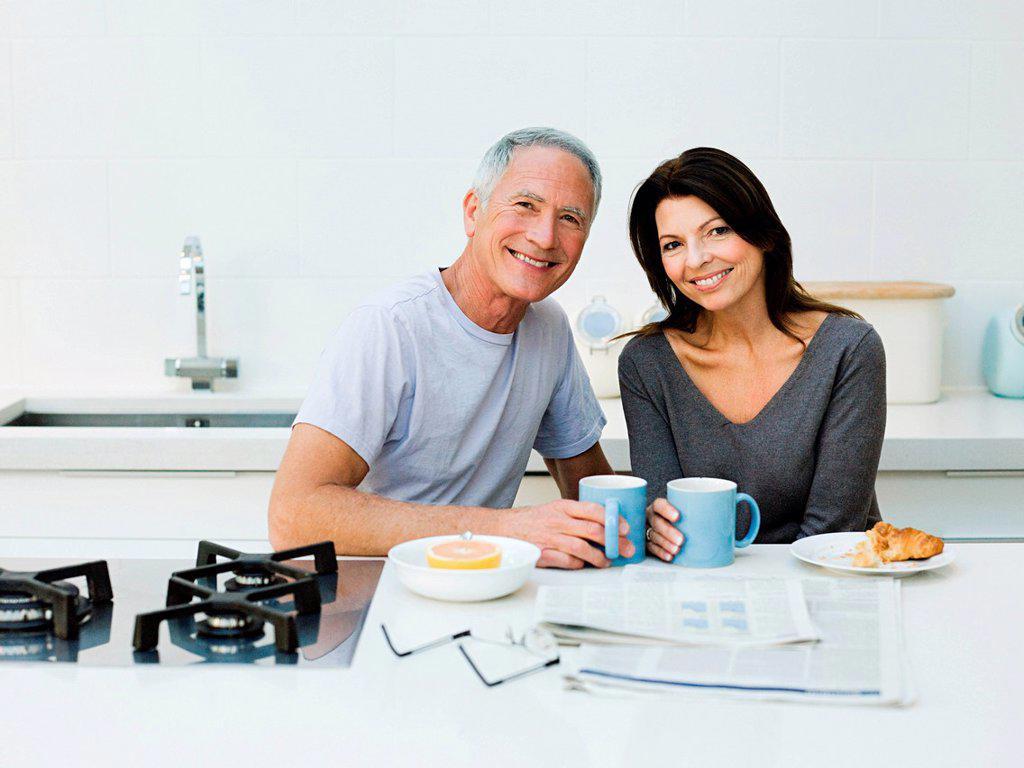 Mature couple having breakfast : Stock Photo