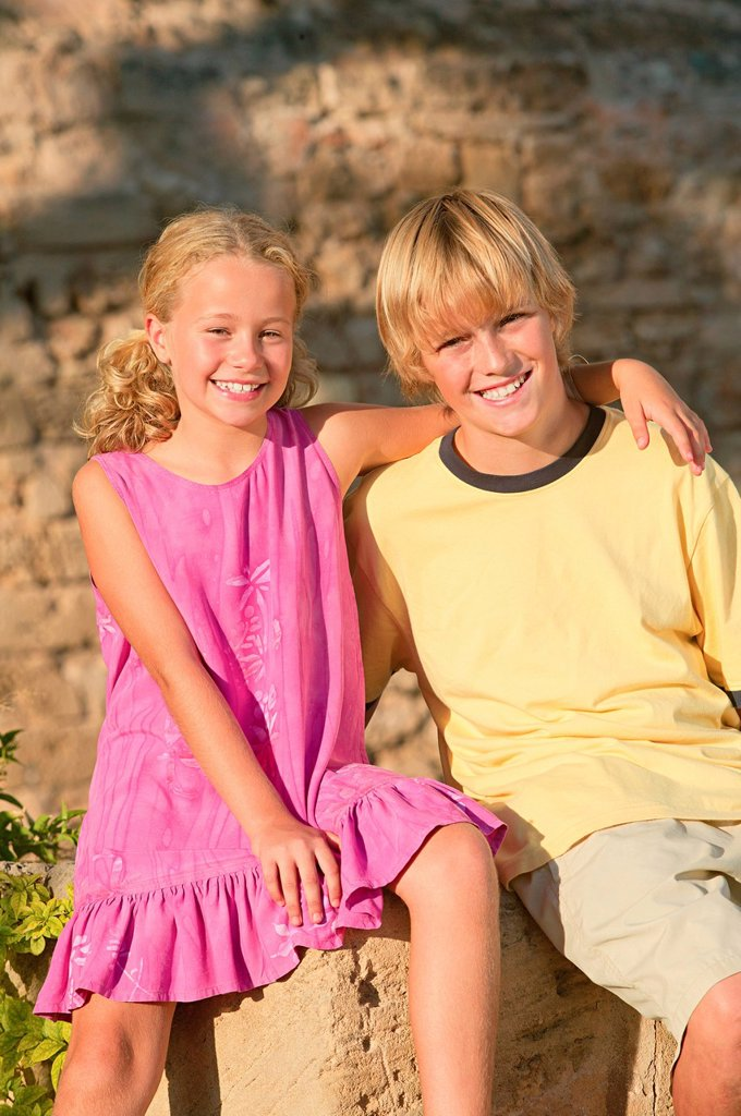 Happy brother and sister outdoors : Stock Photo
