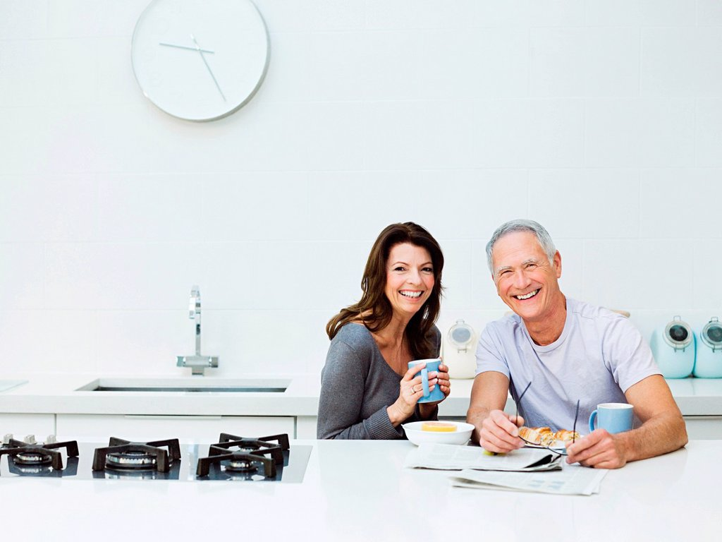 Stock Photo: 1439R-1135047 Mature couple having breakfast