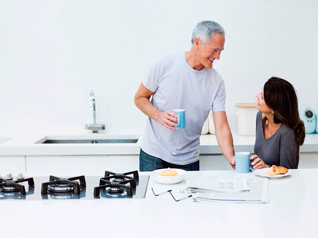 Stock Photo: 1439R-1135050 Mature couple having breakfast