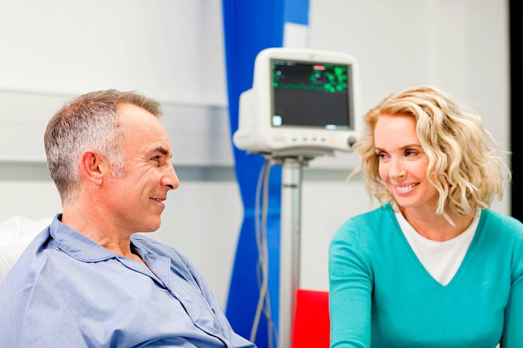 Wife visiting husband in hospital : Stock Photo