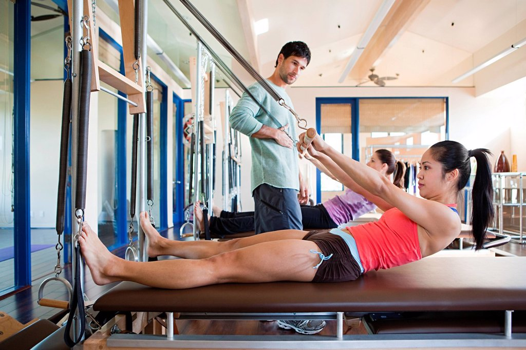 Two women with pilates instructor : Stock Photo