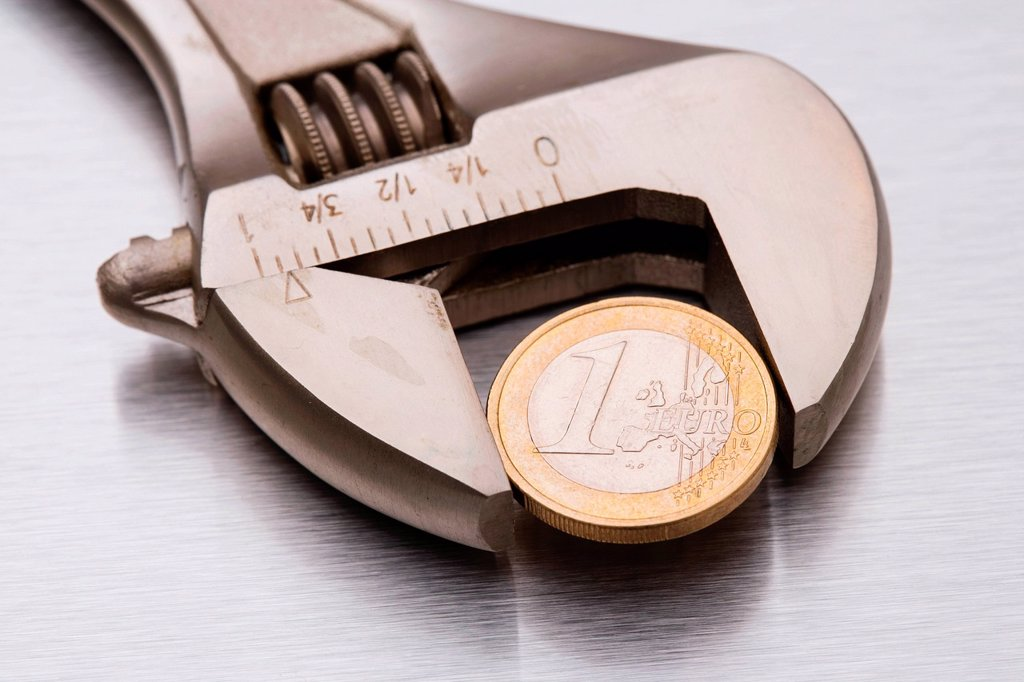 Stock Photo: 1439R-1136531 Euro coin in a wrench