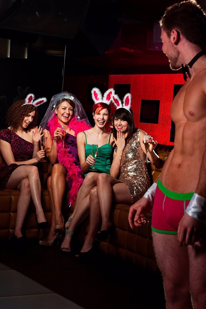 Young women on hen night with male stripper : Stock Photo