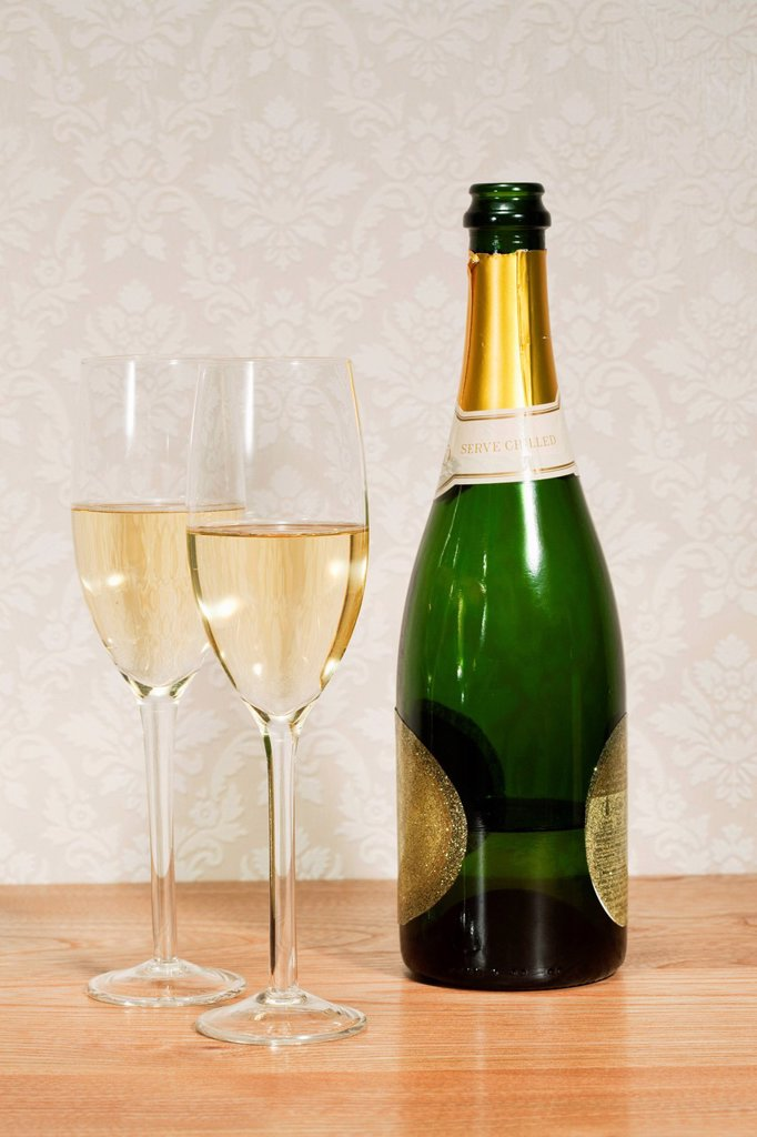 Champagne bottle and two glasses : Stock Photo