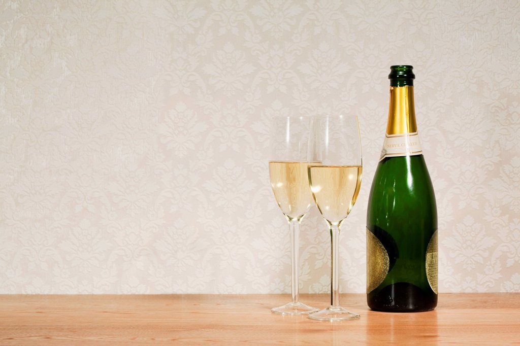 Stock Photo: 1439R-1137878 Champagne bottle and two glasses