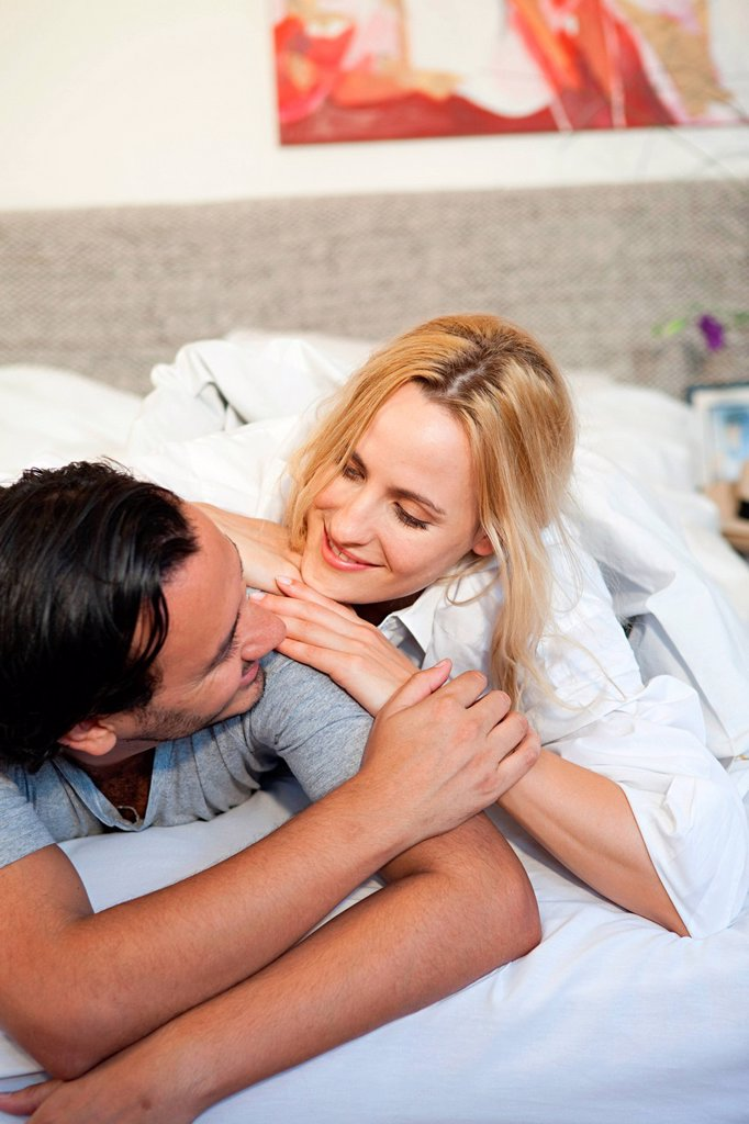 Couple relaxing on bed : Stock Photo