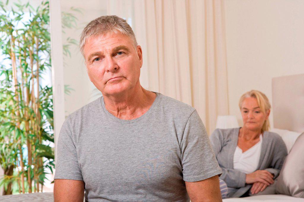 Worried couple in bedroom : Stock Photo