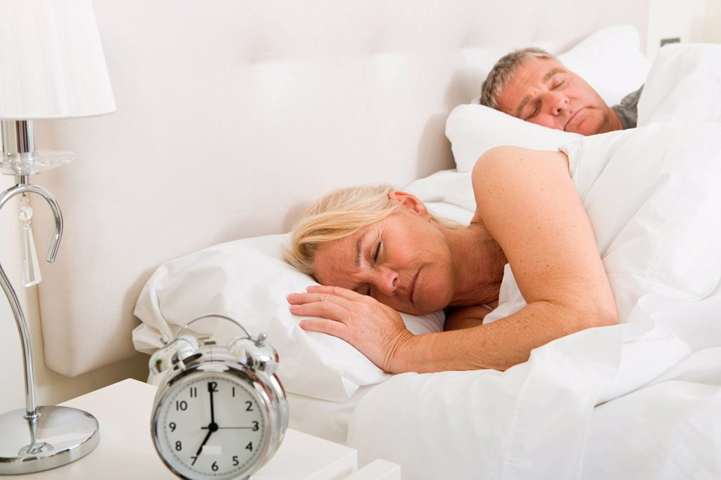 Stock Photo: 1439R-1139297 Couple asleep in bed
