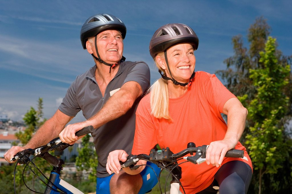 Mature couple on bicycles : Stock Photo