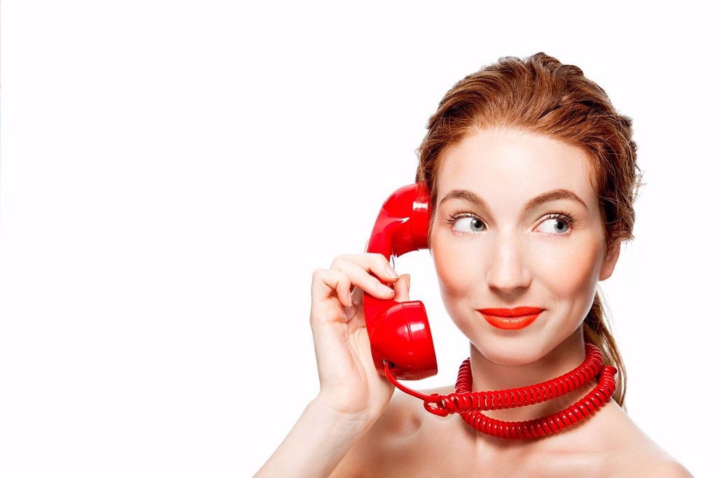Stock Photo: 1439R-1139426 Woman with red telephone cord wrapped around neck