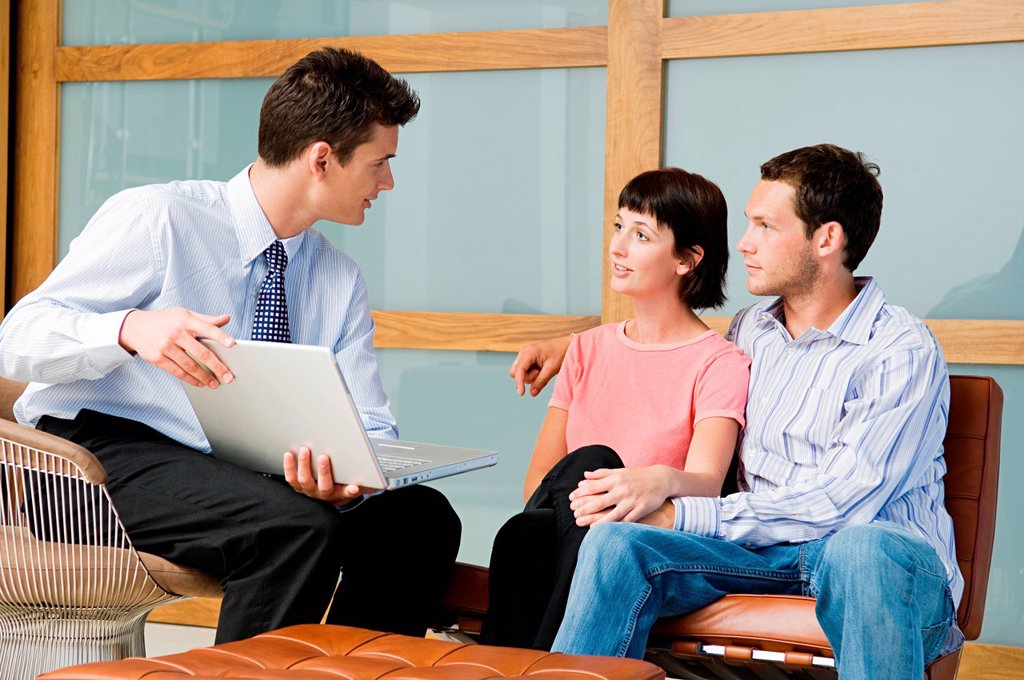 Stock Photo: 1439R-1140262 Couple meeting financial advisor