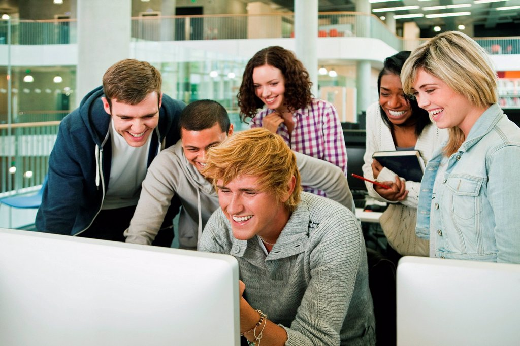 University students watching monitor : Stock Photo