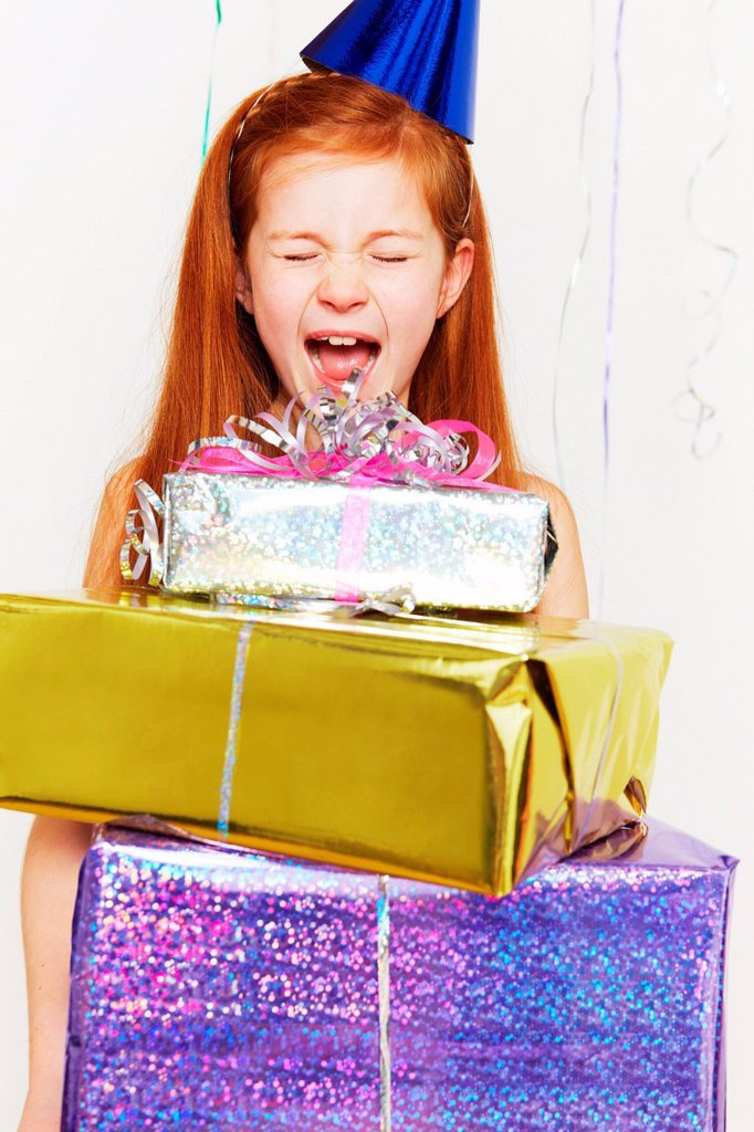 Stock Photo: 1439R-1141984 Screaming girl with stack of birthday gifts