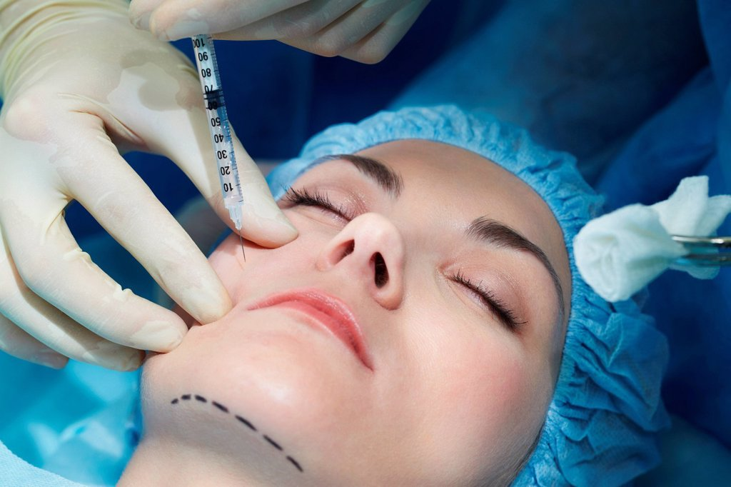 Stock Photo: 1439R-1142149 Young woman having facial plastic surgery