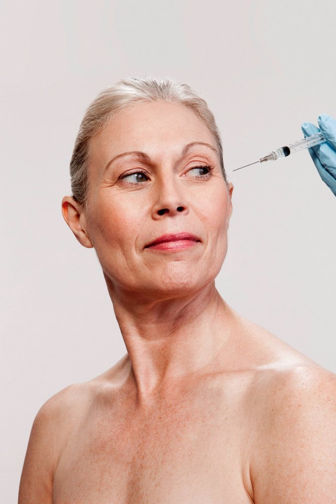 Stock Photo: 1439R-1142253 Mature woman receiving injections