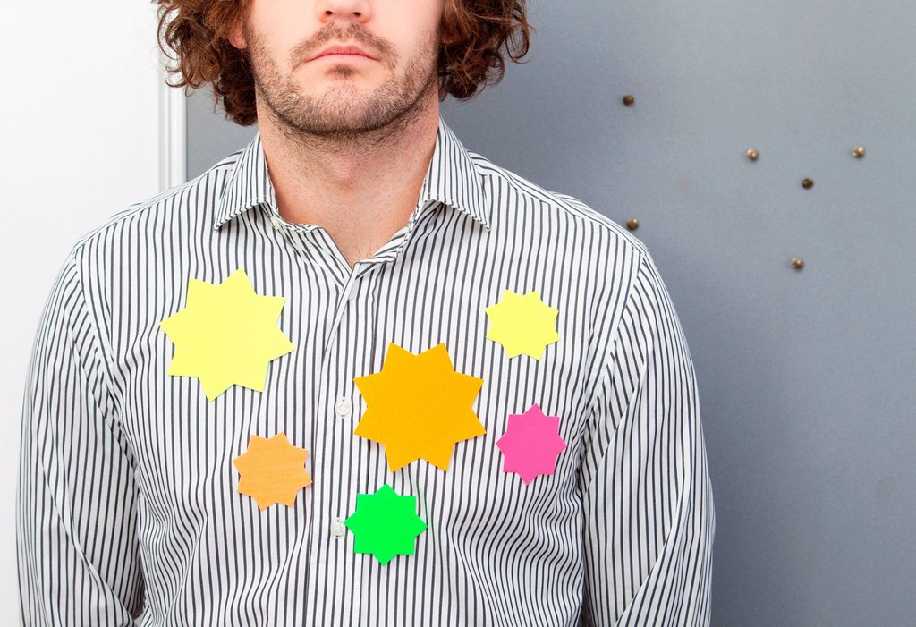 Office worker wearing adhesive notes on shirt : Stock Photo