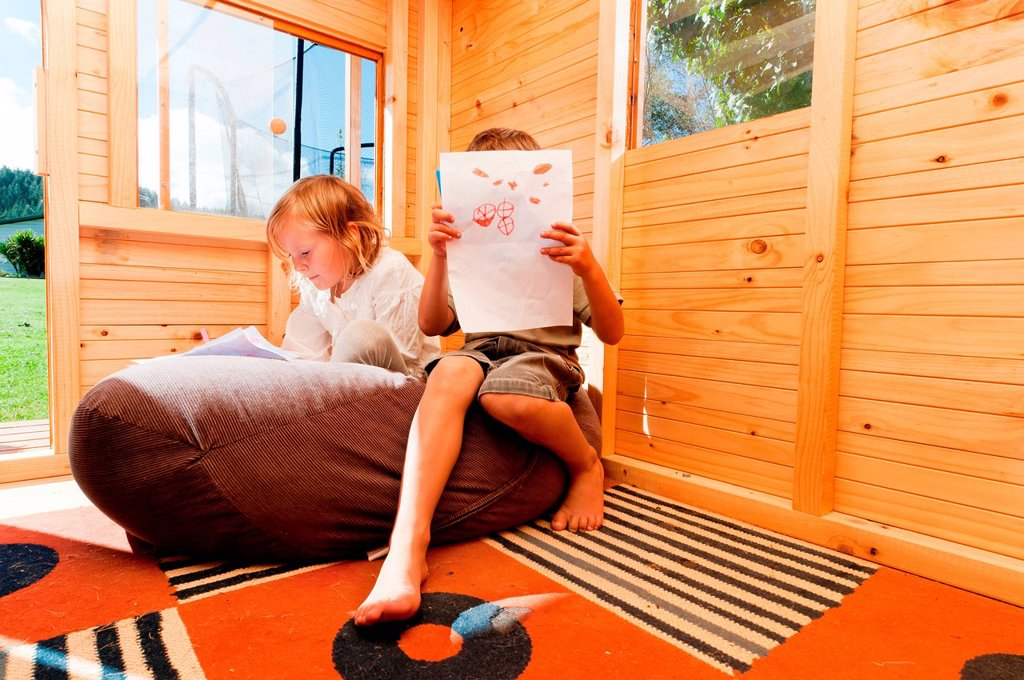 Stock Photo: 1439R-1143379 Children in a wooden playhouse