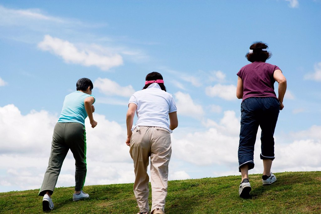 Three senior women walking up a hill : Stock Photo