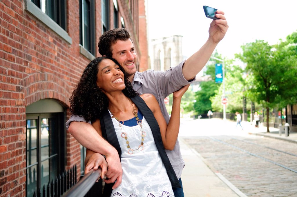 Couple taking a picture of themselves : Stock Photo