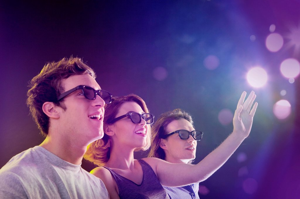 People in 3D glasses looking towards light : Stock Photo