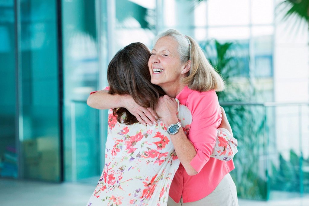 Stock Photo: 1439R-1144601 Adult mother and daughter embracing