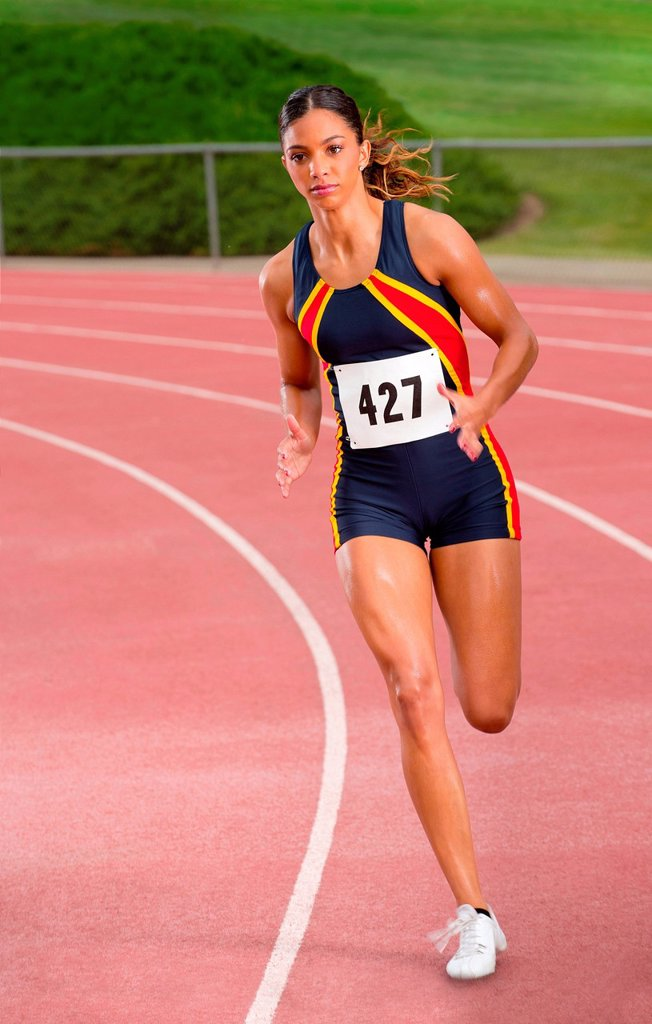 Stock Photo: 1439R-1144658 Female athlete running on track