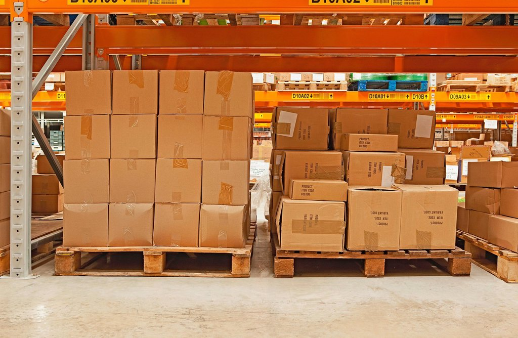 Cardboard boxes in warehouse : Stock Photo