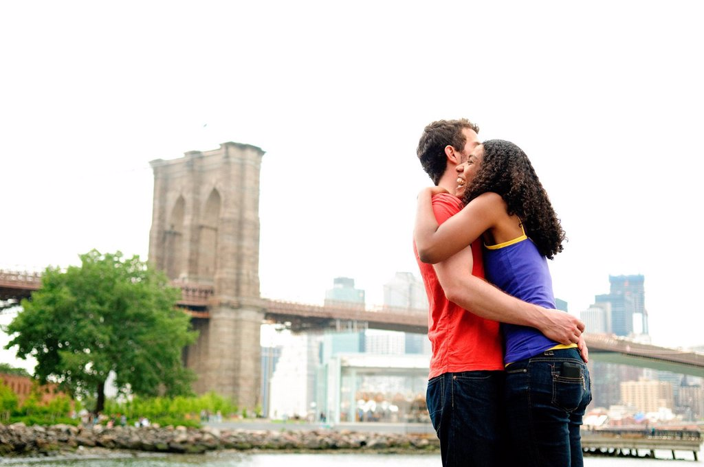 Stock Photo: 1439R-1144772 Couple hugging by Brooklyn Bridge