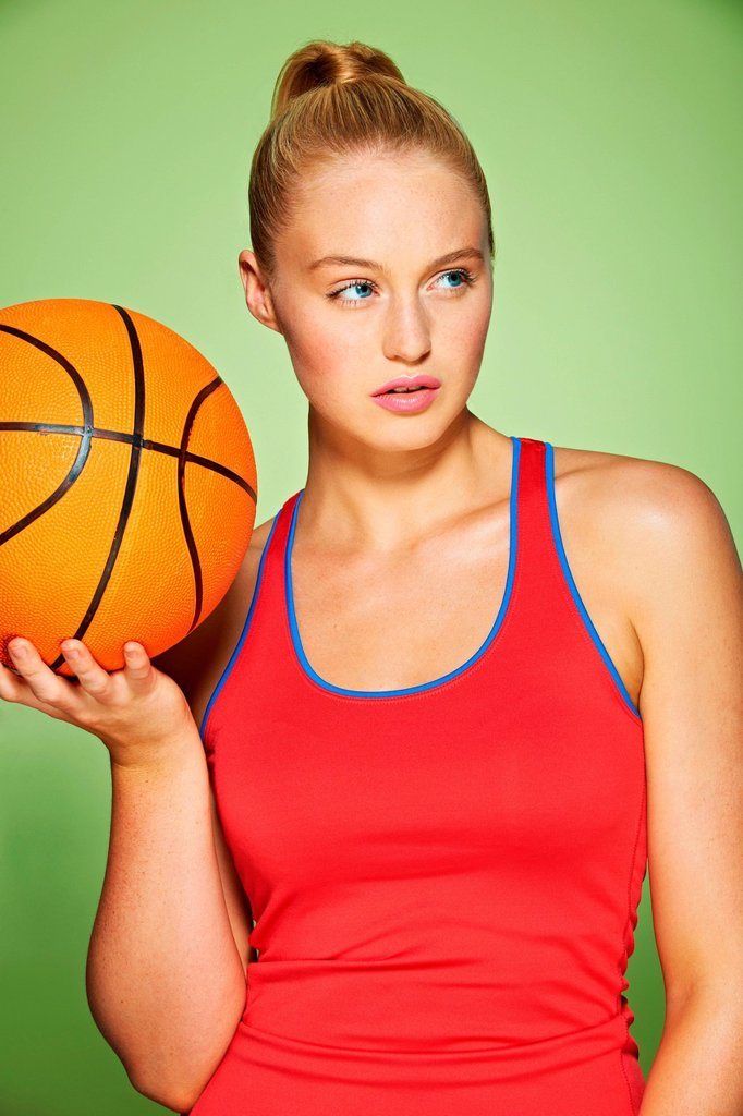 Young woman with basketball : Stock Photo