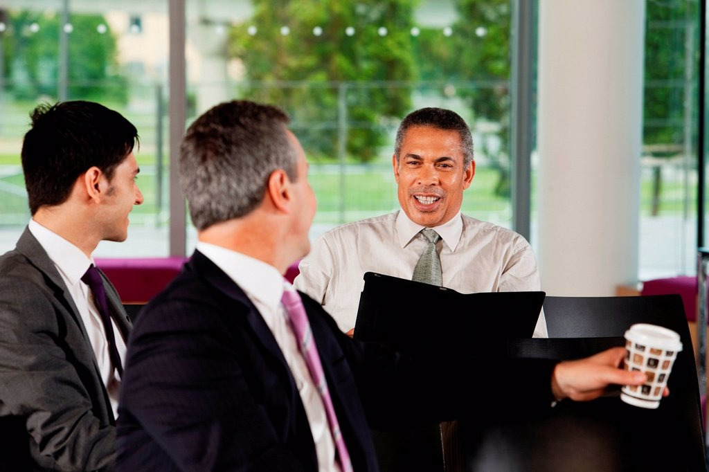 Businessmen having conversation : Stock Photo