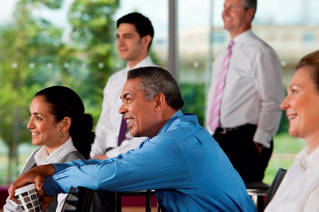 Stock Photo: 1439R-1145161 Businesspeople at presentation