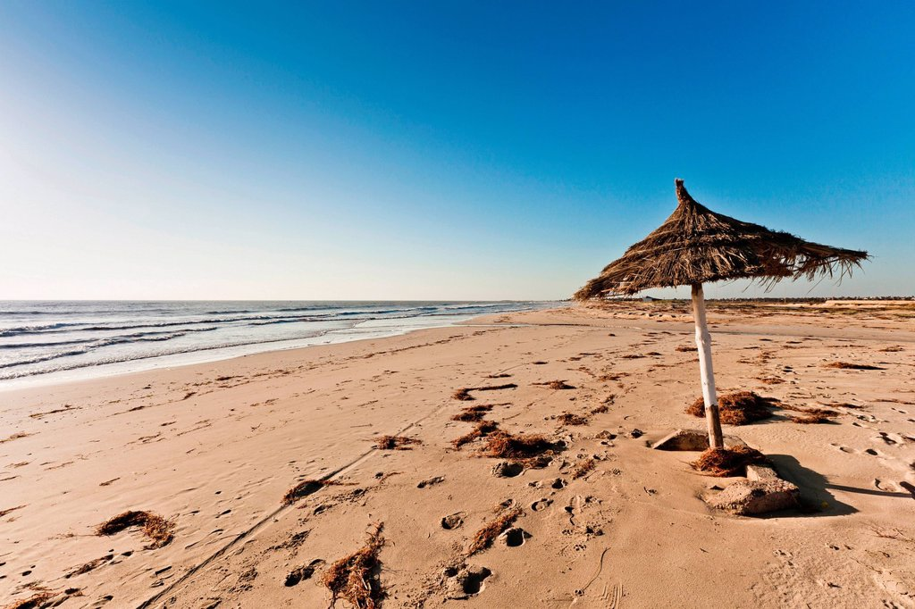 Stock Photo: 1439R-1145399 Parasol on beach on island of Djerba, Tunisia