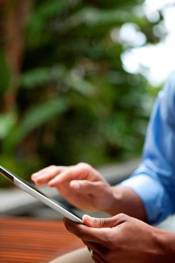 Man using digital tablet : Stock Photo