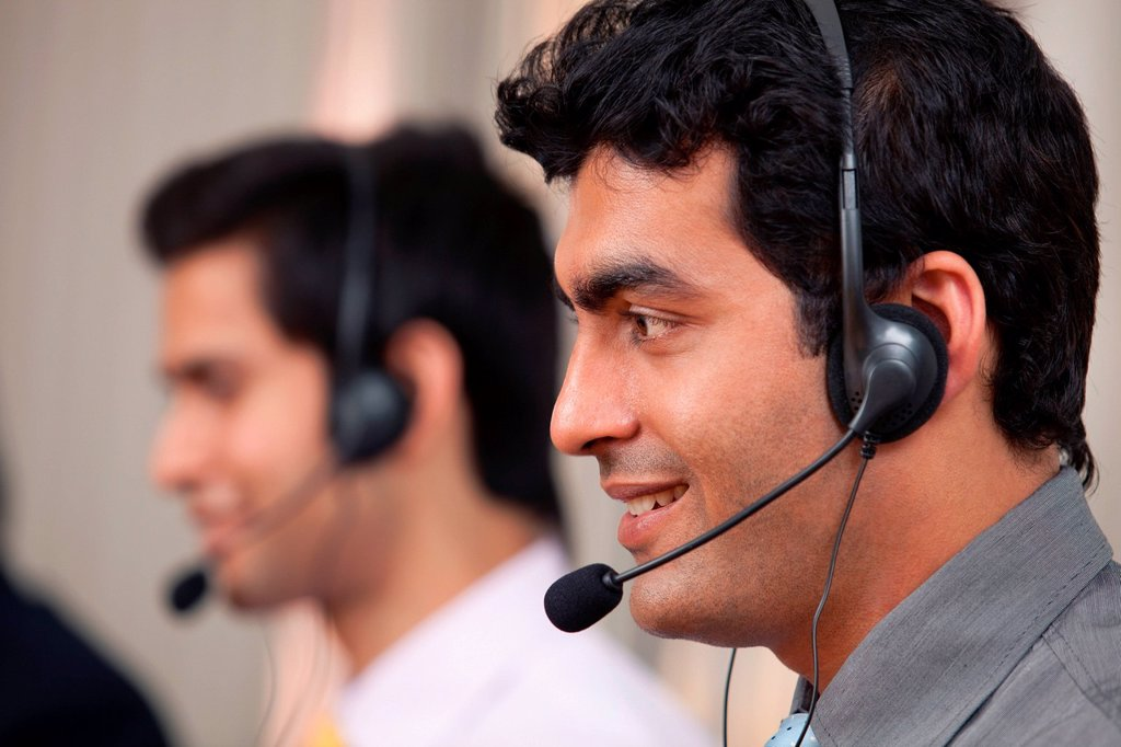 Call center agent smiling : Stock Photo