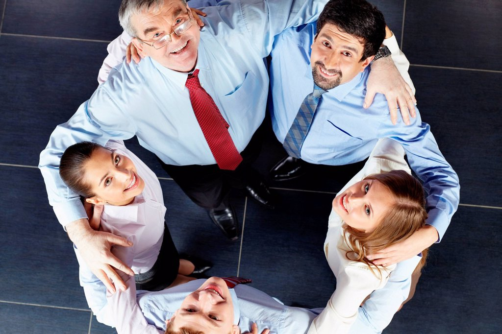 Stock Photo: 1439R-1146000 Colleagues with arms around each other