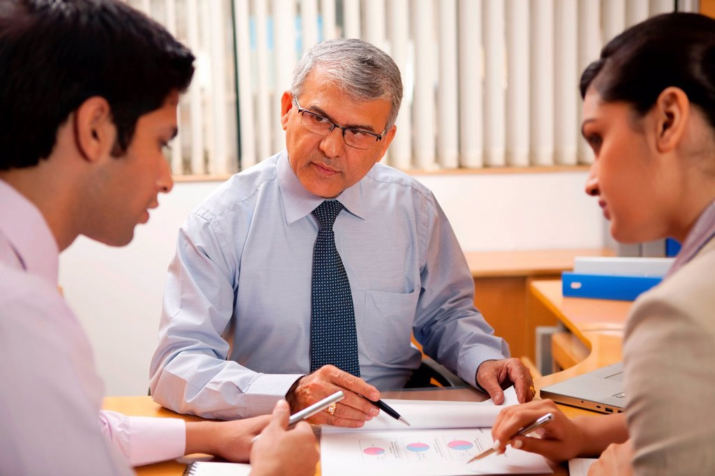 Business executives having a discussion : Stock Photo