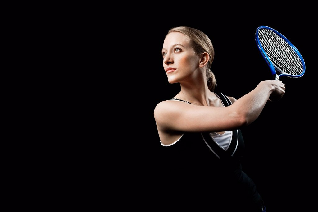 Stock Photo: 1439R-1146813 Tennis player holding racket