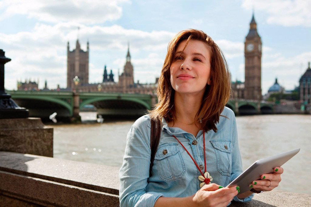 Stock Photo: 1439R-1147131 Young woman using a digital tablet in London
