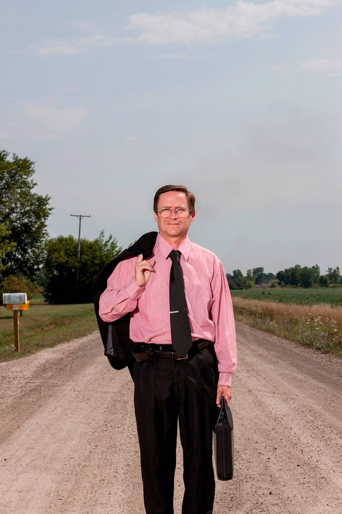 Stock Photo: 1439R-1147366 Businessman on country road
