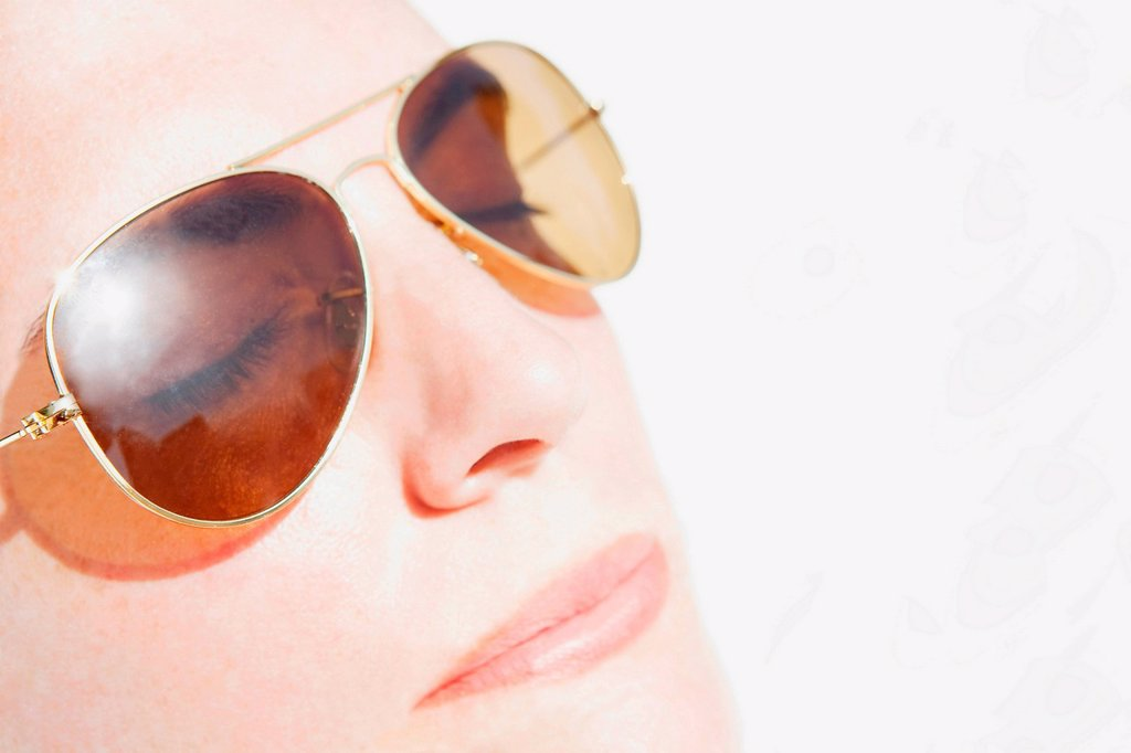 Stock Photo: 1439R-1147373 Woman´s face in sunlight