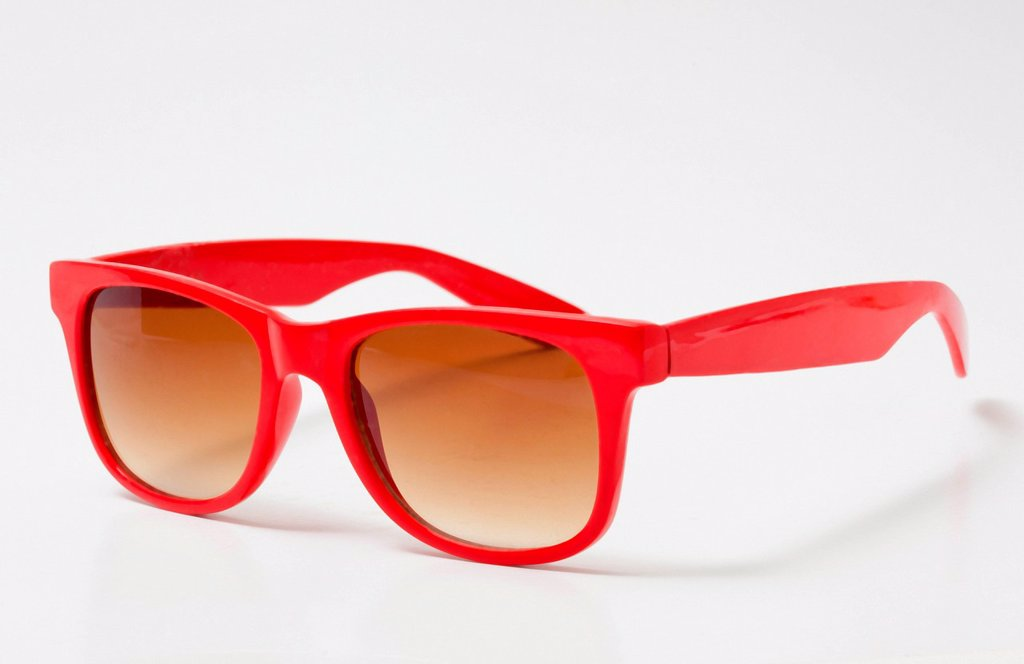 Pair of red sunglasses : Stock Photo