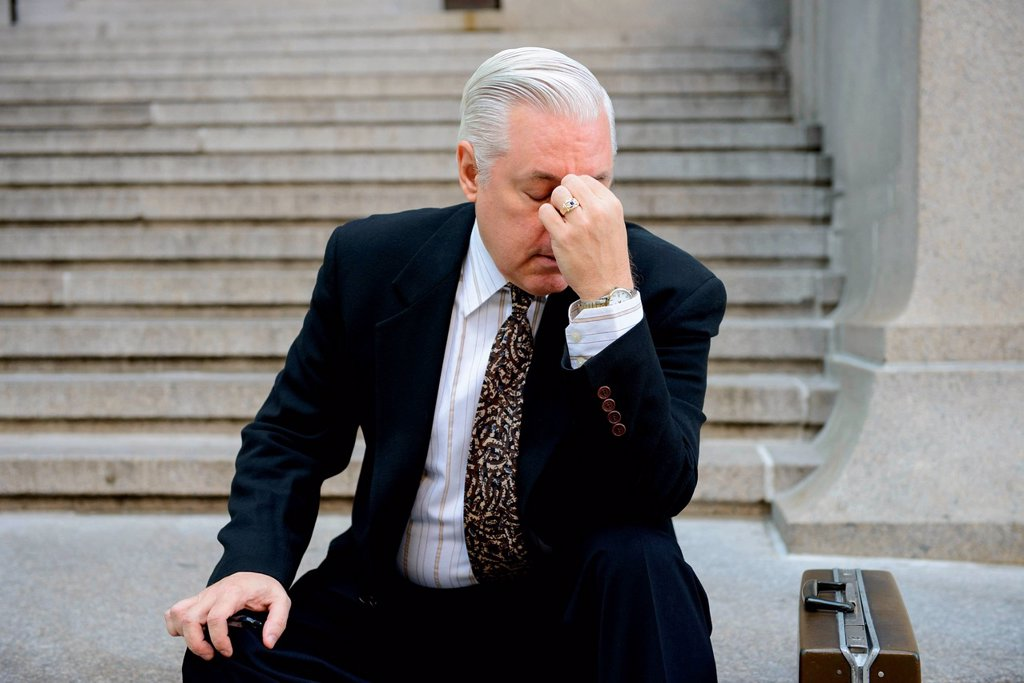 Stressed businessman on steps : Stock Photo